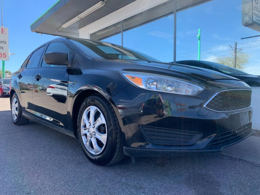 2015 Black /Charcoal Black Inser Ford Focus S Sedan (1FADP3E26FL) with an 2.0L L4 DOHC 16V engine, 5-Speed Manual transmission, located at 2231 W Main St., Mesa, AZ, 85201, (480) 707-9008, 33.415115, -111.848190 - Photo #0